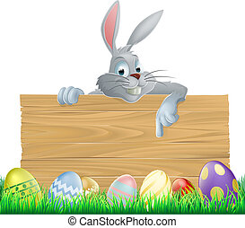 Easter eggs and bunny sign - An Easter bunny rabbit wooden...
