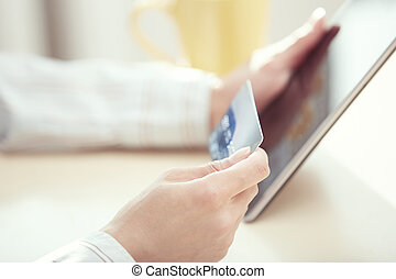 Online banking - Human hands with tablet PC and credit card...