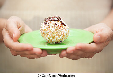Coconut Cake - Human hands holding green plante with coconut...