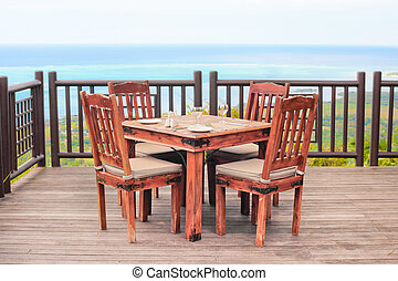 Dining table - Outside dining table and chairs on a wooden...