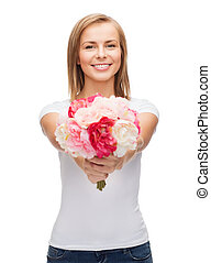 smiling woman with bouquet of flowers - holidays, love and...