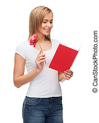 smiling girl with postcard and flower - love, holidays and...