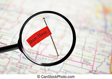 start here - pin with stuck into a map with magnifying glass...