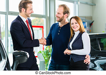 Dealer, clients and auto in car dealership - Seller or car...