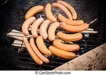 Sausages in a ghetto grill
