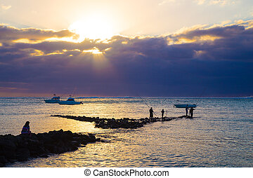sea fishing at sunset - fishermen catch fish at sunset Boat...