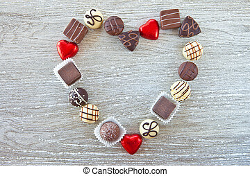 Various chocolates in a heart-shape - Little hearts and...