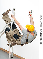 Falling from ladder - A worker with a yellow helmet falling...
