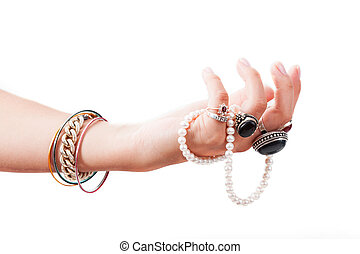 Hand with jewelery - A hand full of bracelets and expensive...