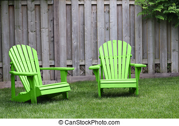 Green Adirondack Chairs - Two green adirondack chairs on...
