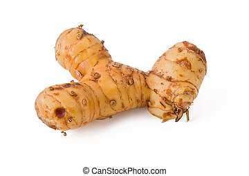 Galangal - Fresh galangal, or blue ginger, against a white...