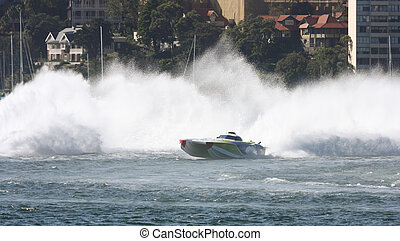 Powerboat - A Powerboat racing across the water with a...