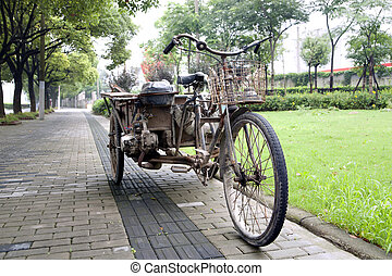 rusty Chinese tricycle - Old rusty Chinese tricycle with...