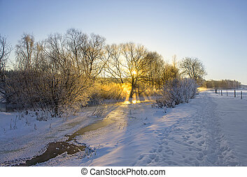 frozen river in winter landscape - small frozen river in...