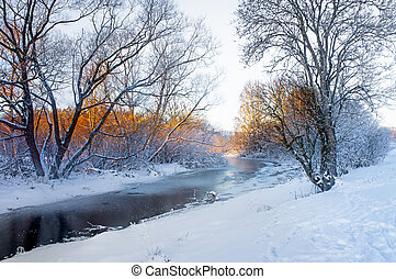 River in winter - small frozen river in beautiful...