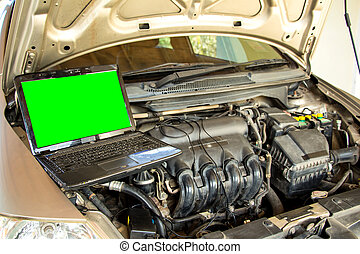 Car mechanic checking engine