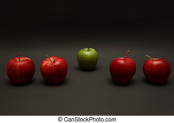 Odd One Out - A line of apples, with one red one out.