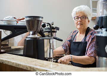 Portrait of Senior Barista Preparing Coffee - Senior barista...