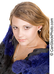 Portrait of the beauty young woman in a fur coat