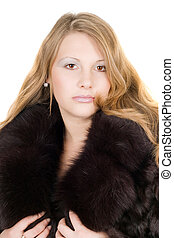 Portrait of the beautiful young lady in a fur coat