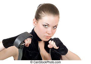 Pretty young angry woman throwing a punch