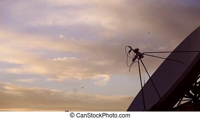 Eighty degrees east - A satellite antenna at sunset,...