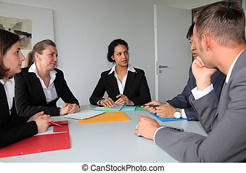 Young dedicated business team in a meeting