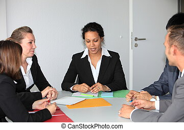 Manageress holding a business meeting