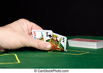 Black Jack - A black jack player holding an ace and a king -...