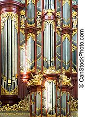 Church Organ - A close up of a church organ with pipes in...