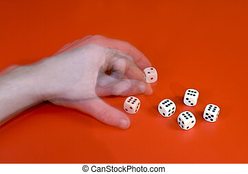 Cheating with dice - A man\'s left arm changing a dice,...