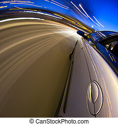 Around the bend - A car driving at high speed through a...