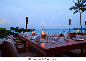 Romantic dinner setting at the beach on sunset, outdoor...