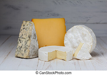 Cheese variety on wooden table