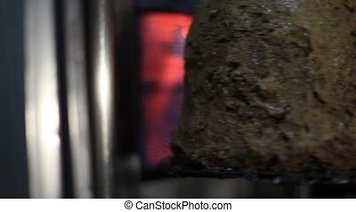 Doner kebab being roasted...the focus goes from the...