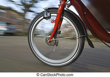 Spinning bicycle wheel - The spinning and vibrating wheel of...