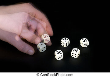 Cheating - A mans left hand turning the dice, cheating at a...