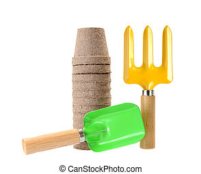 Gardening tools and paper pot on white background