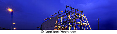 Construction site - A construction site at night, showing...