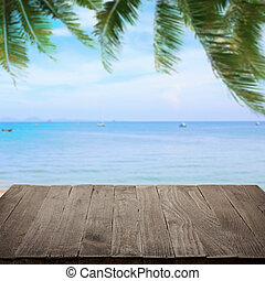 Empty wooden table with tropical sea on background, blank...