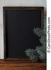Chalkboard with christmas fir branches