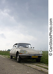 Vintage car on Dutch Dyke - A classic french car parked on...