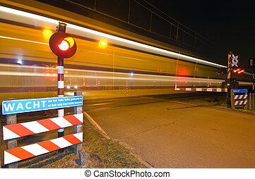 Intercity - An intercity passing a railroad crossing at...