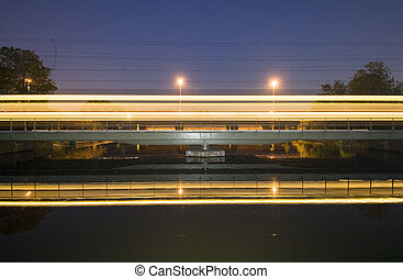 Intercity on railway bridge - An intercity racing over a...
