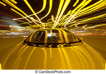 Driving Chaos - A car driving through the frantic traffic of...