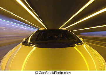 Highway Speeding - A car, seen from the front racing at high...