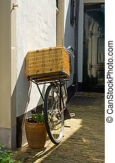 Old Bike - An old bike with a basket on the handle bar...