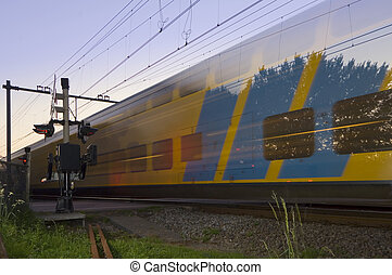 Passing train - A passing train at full speed during sunset