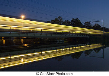 Reflection of a passing train - The reflection of an...