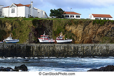 Boats on the shore at Santa Cruz, Azores archipelago...
